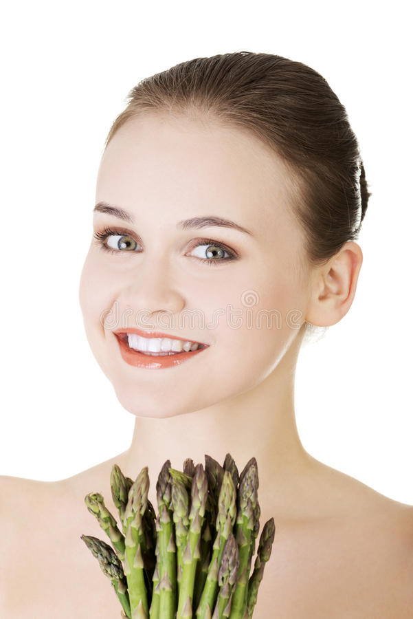 Pretty woman with healthy food - asparagus. Isolated on white stock photos