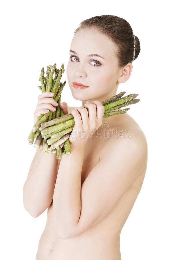 Pretty woman with healthy food - asparagus. Isolated on white stock images
