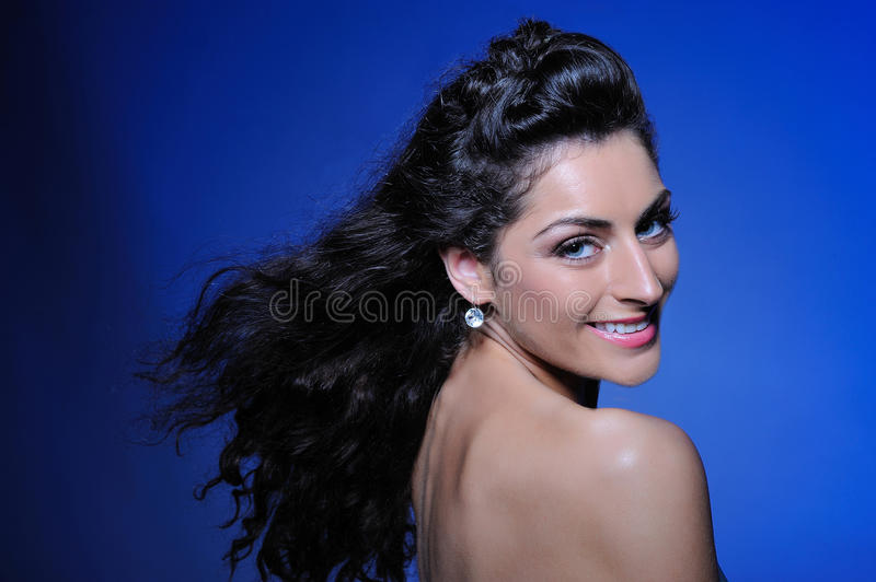 Pretty woman with healthy long flying hair stock images