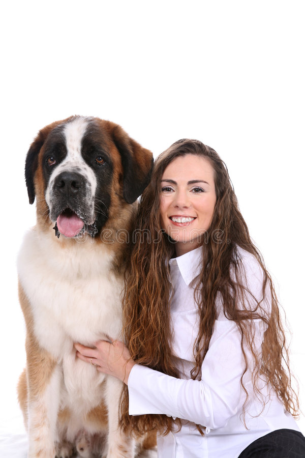 Pretty Woman And Her Saint Bernard Dog Side By Sid Royalty Free Stock Photos