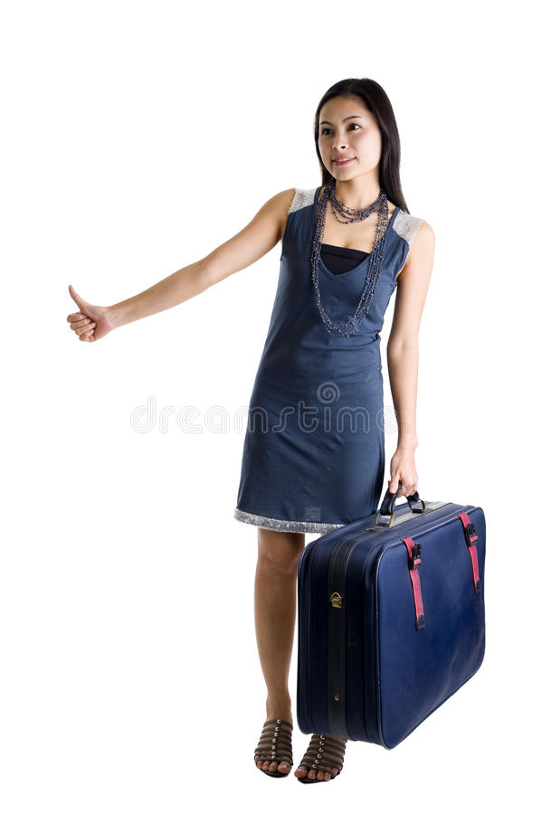 Pretty woman hitchhiking. Isolated on white background royalty free stock image