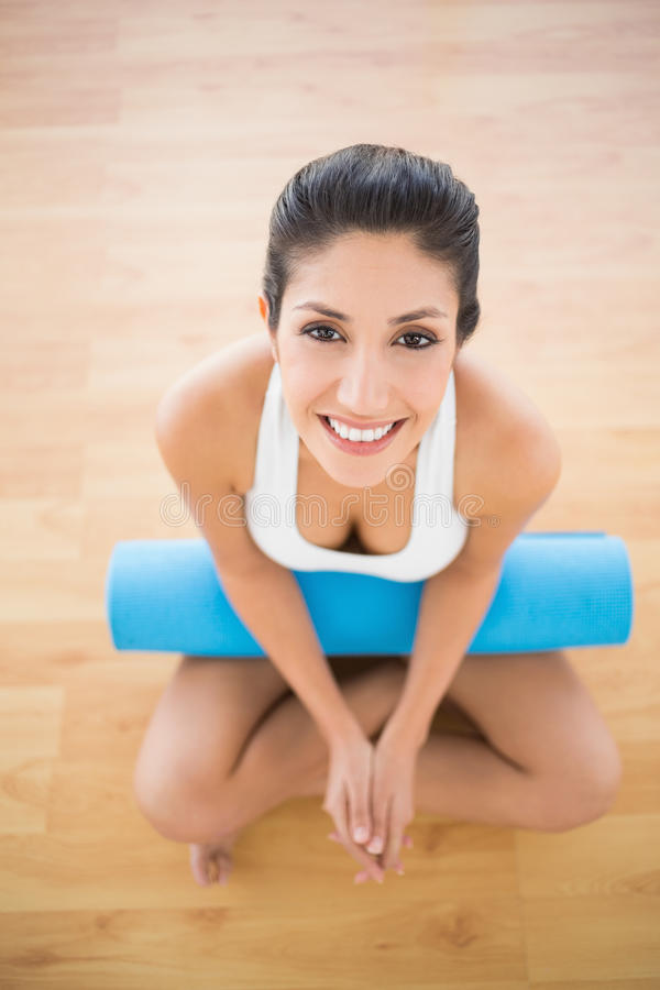 Download Pretty Woman Holding Her Exercise Mat Sitting And Smiling At Camera Stock Photo - Image: 33719832