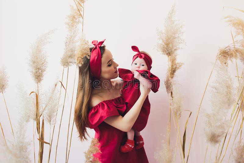 Pretty woman holding a newborn baby in her arms. stock images