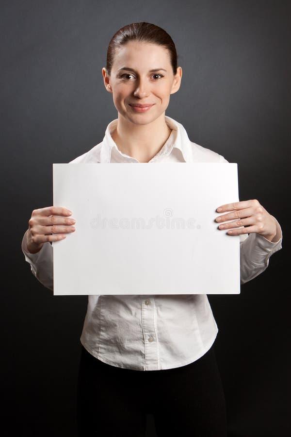 Pretty woman holding white poster stock photos