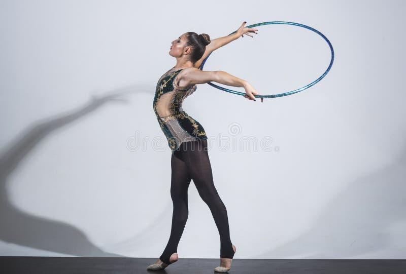 Pretty woman with hoola hoop in studio. Pretty woman with hoola hoop in studio royalty free stock photography