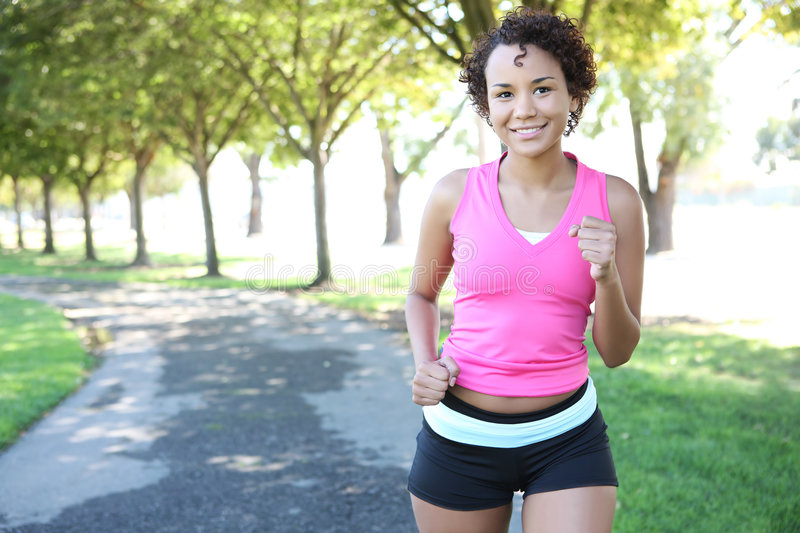 Pretty Woman Jogging in Park royalty free stock photo
