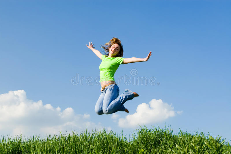 Pretty woman is jumping royalty free stock photos