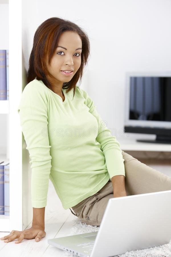 Pretty woman with laptop at home royalty free stock photo