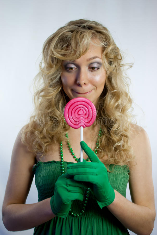 Pretty woman with large lollipop