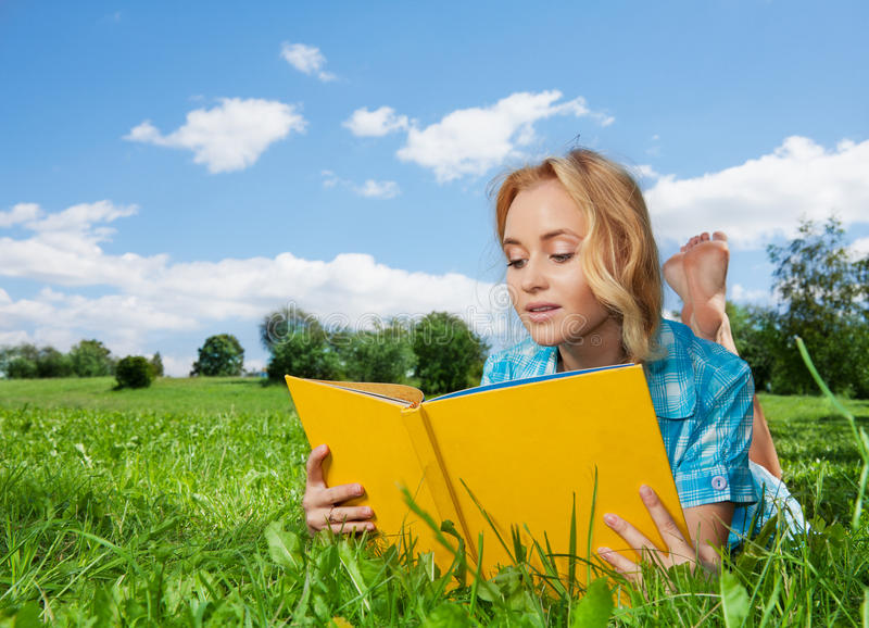 Pretty woman laying on lawn royalty free stock image