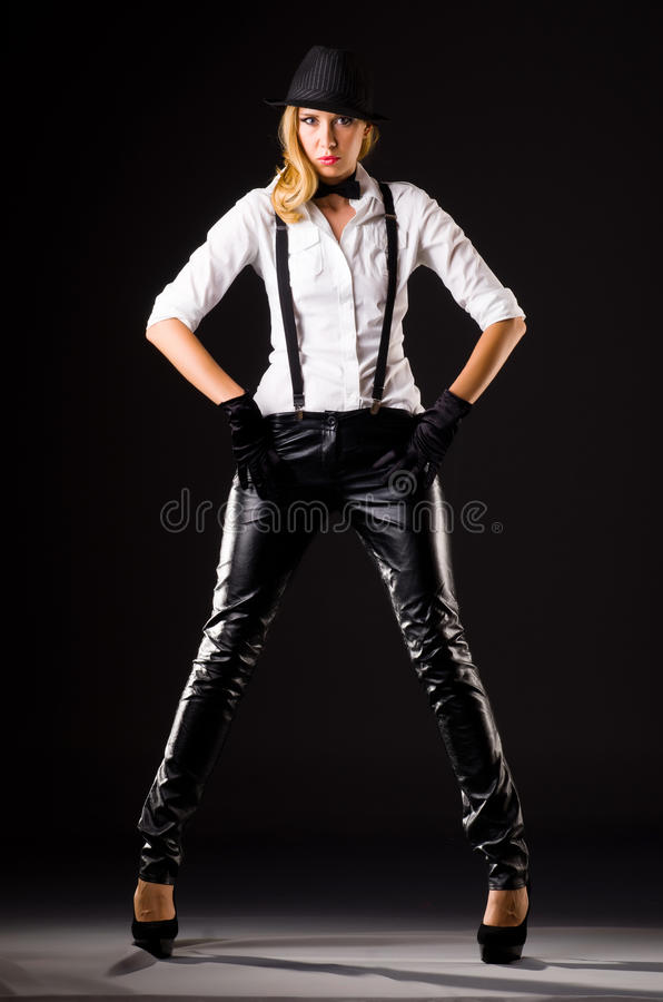 Pretty woman in lear pants isolated on white stock photo
