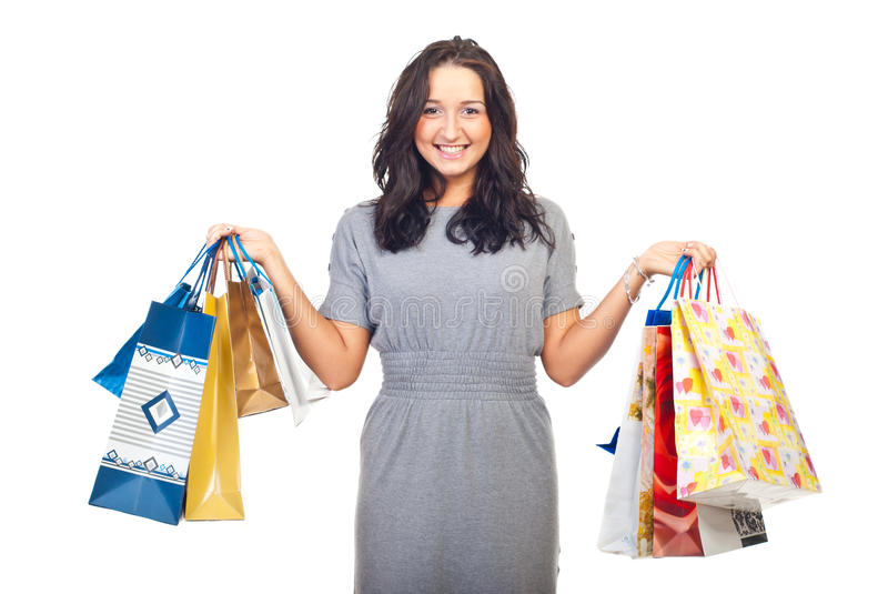 Pretty woman lifting shopping bags stock photography