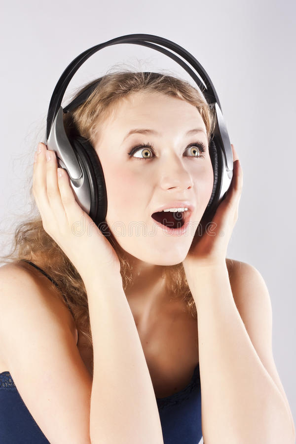 Download Pretty Woman Listening, And Enjoying Music Stock Photo - Image: 24355406