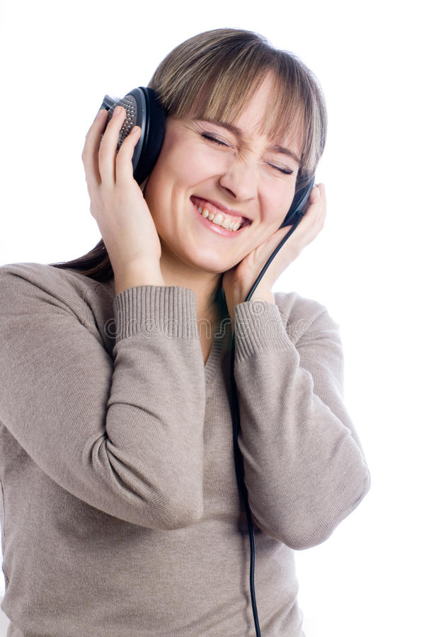 Pretty woman listening music stock images