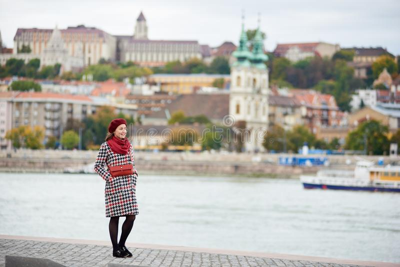 Pretty woman lonely stand the embankment of Budapest stock photo