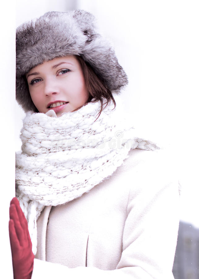 Pretty woman look in winter with furry cap royalty free stock photos