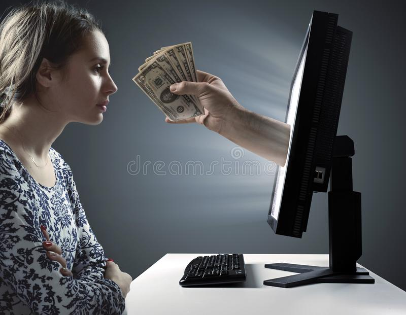 Woman looking at the bunch of money - Internet financial trap symbol royalty free stock image