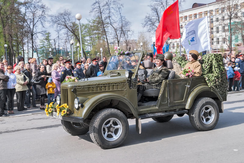 Pretty woman - major of army drives car on parade royalty free stock photos