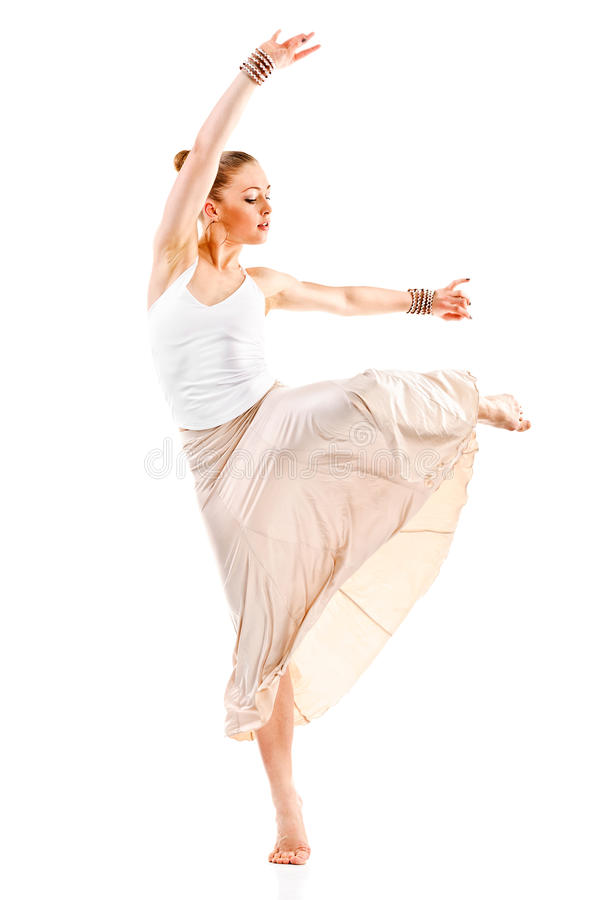 Pretty woman modern style dancer jumping and dancing. Isolated on a white royalty free stock photo