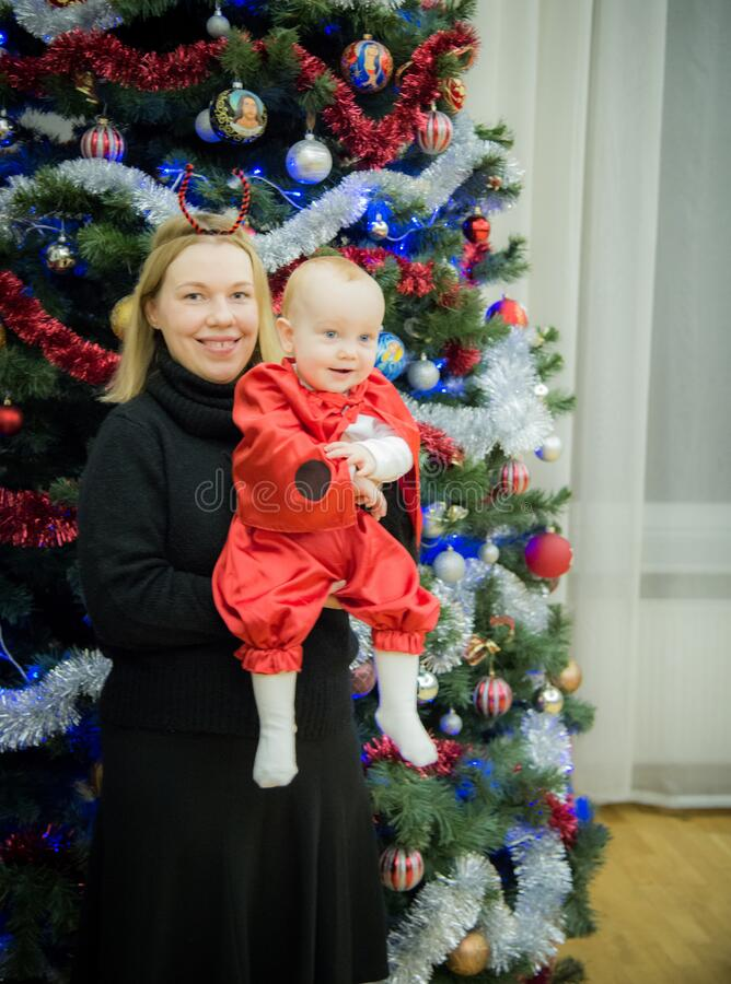Woman mother with child in Christmas background royalty free stock photography
