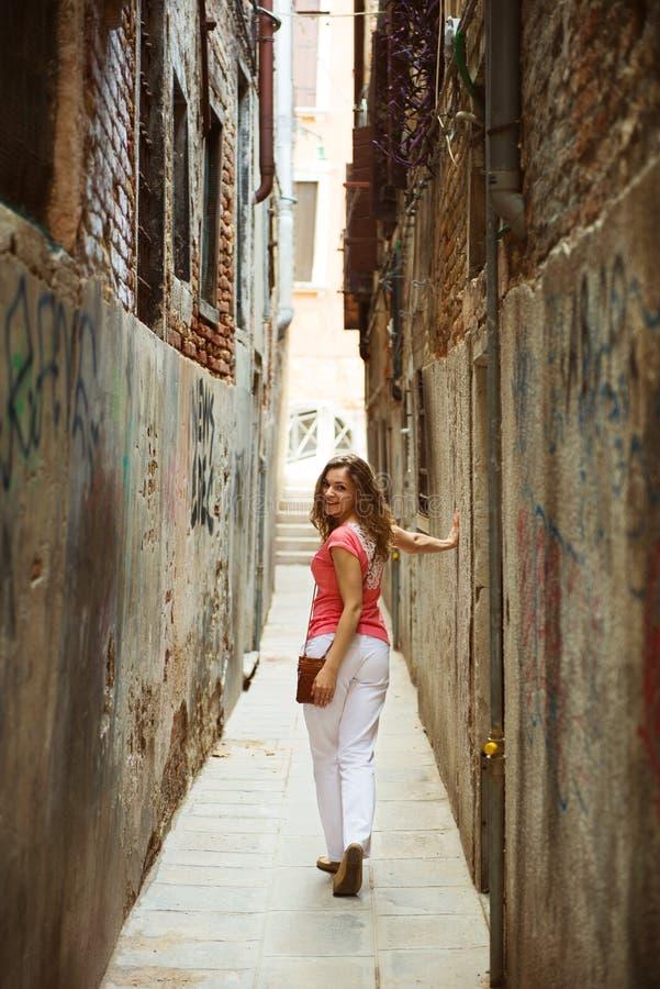 Pretty woman in narrow Venice street. Pretty young woman in narrow Venice street stock image