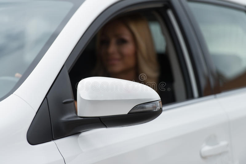 Pretty Woman In A New Car stock photos