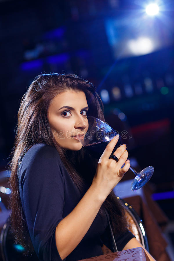 Pretty woman in nightclub royalty free stock photos