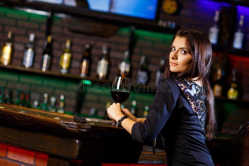Pretty woman in nightclub royalty free stock photography