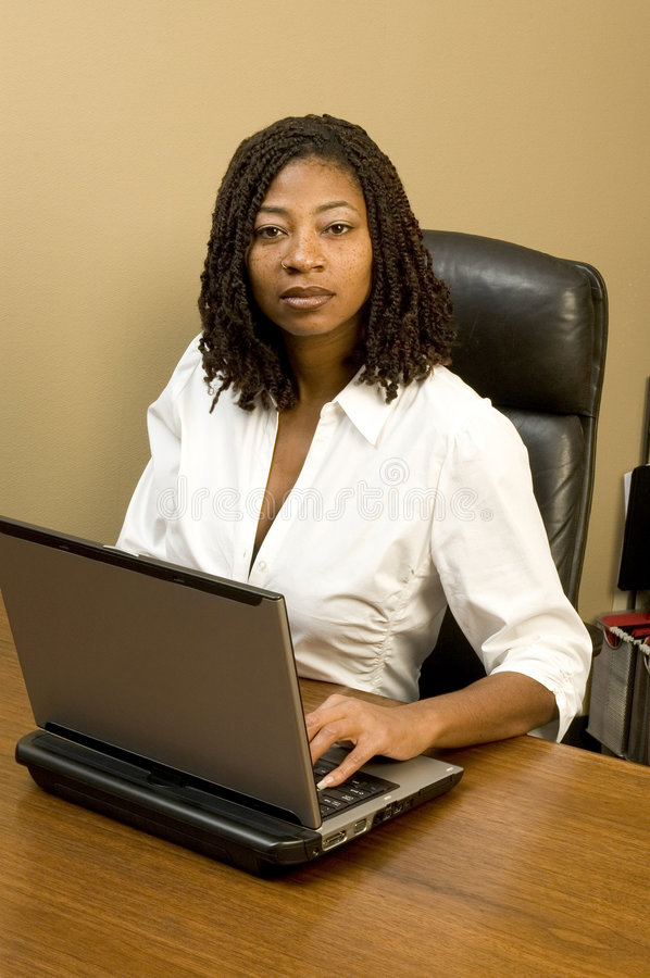 Pretty woman in office stock photos