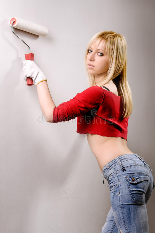 Download Pretty Woman With Painting Roller Stock Image - Image: 10498239