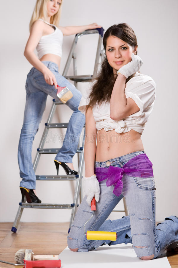 Pretty woman with painting roller royalty free stock photo