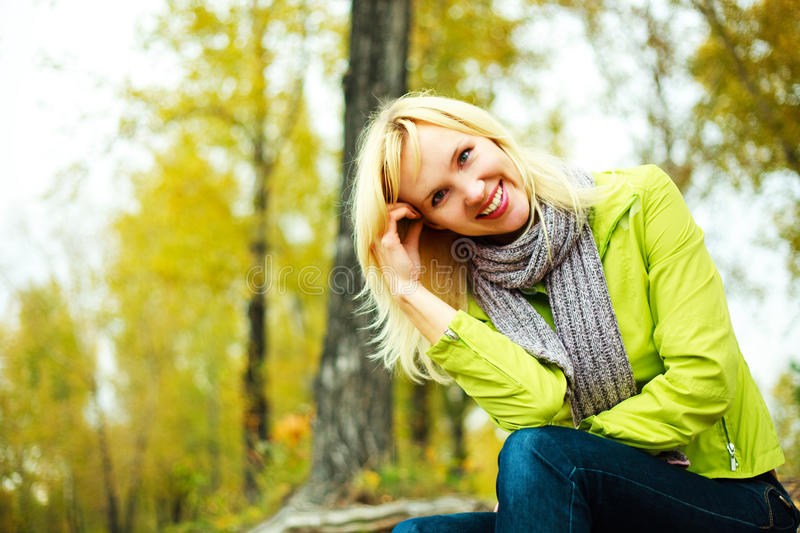 Pretty woman in the park stock photography