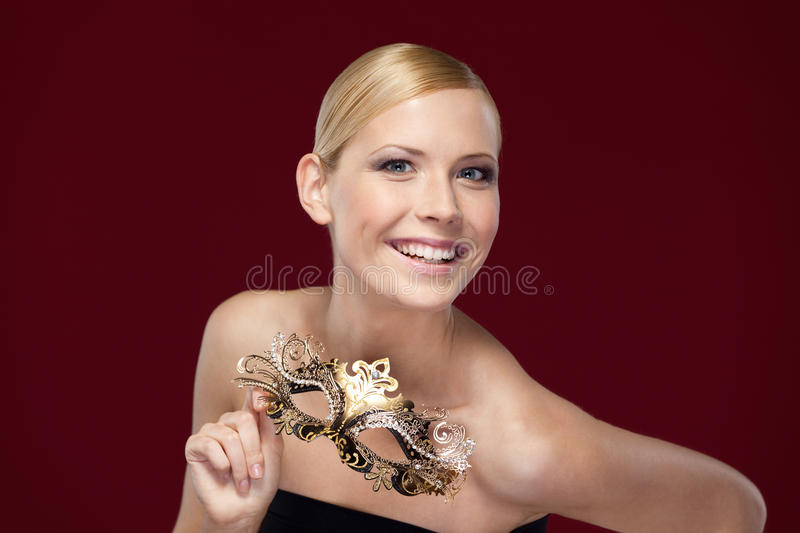 Download Pretty Woman With Patterned Masquerade Mask Royalty Free Stock Photography - Image: 26322487
