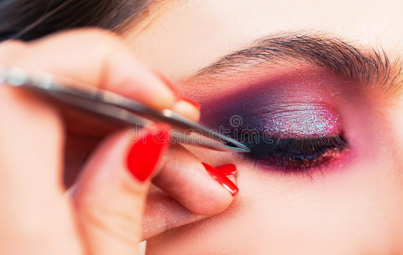 Pretty woman with perfect eyelashes. Female beauty visage concept for eyelashes. A professional make-up artist paints stock photography