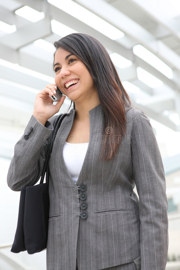 Download Pretty Woman On Phone At Office Stock Photo - Image: 5324658