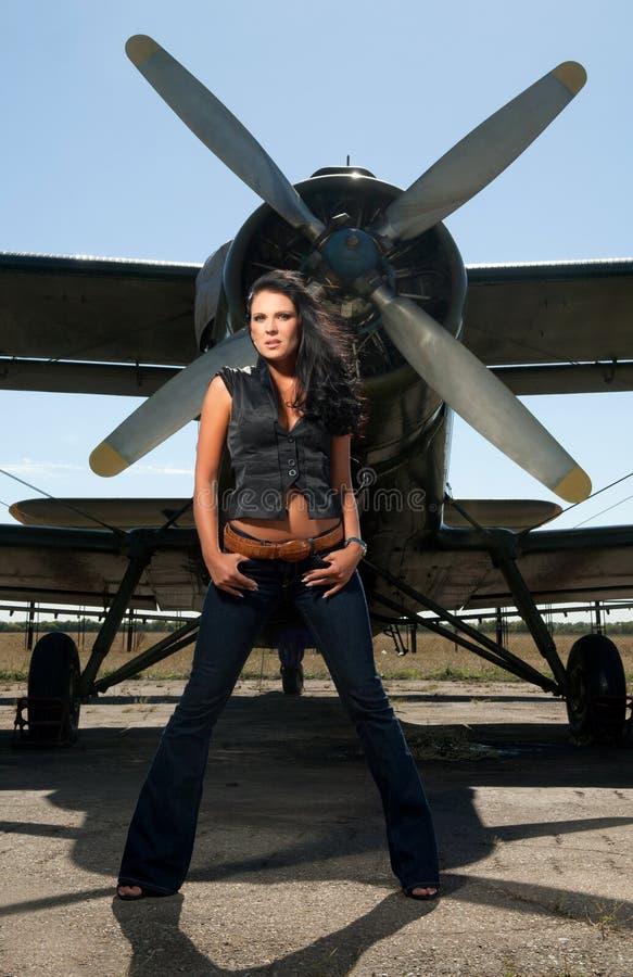 Pretty woman and a plane