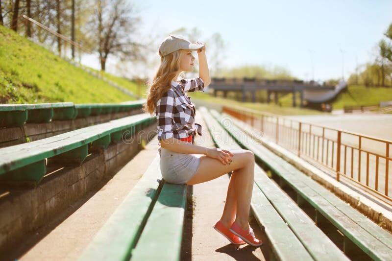 Pretty woman posing in urban style stock photo