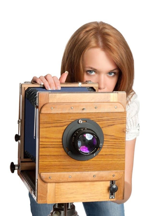 Pretty woman posing vintage camera royalty free stock photos