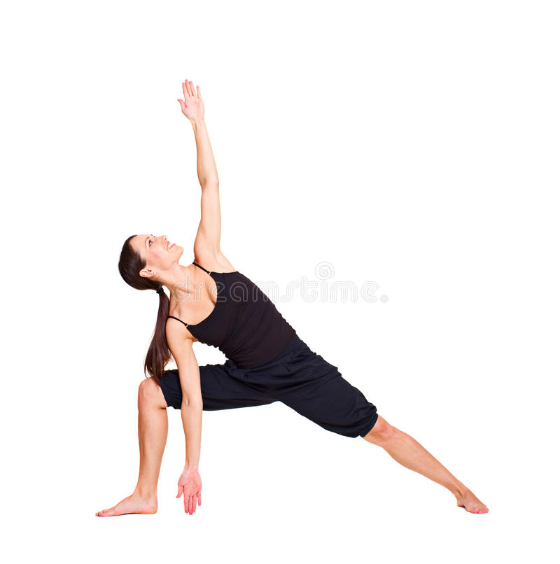 Pretty woman practicing yoga royalty free stock image