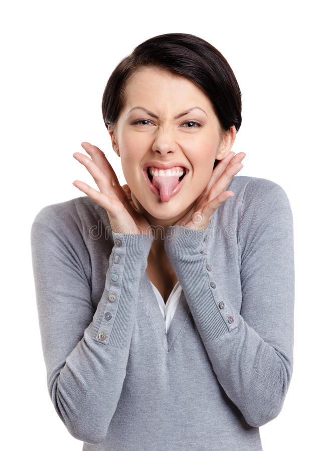 Pretty woman puts out tongue. Young pretty woman puts out tongue, isolated on white royalty free stock photos