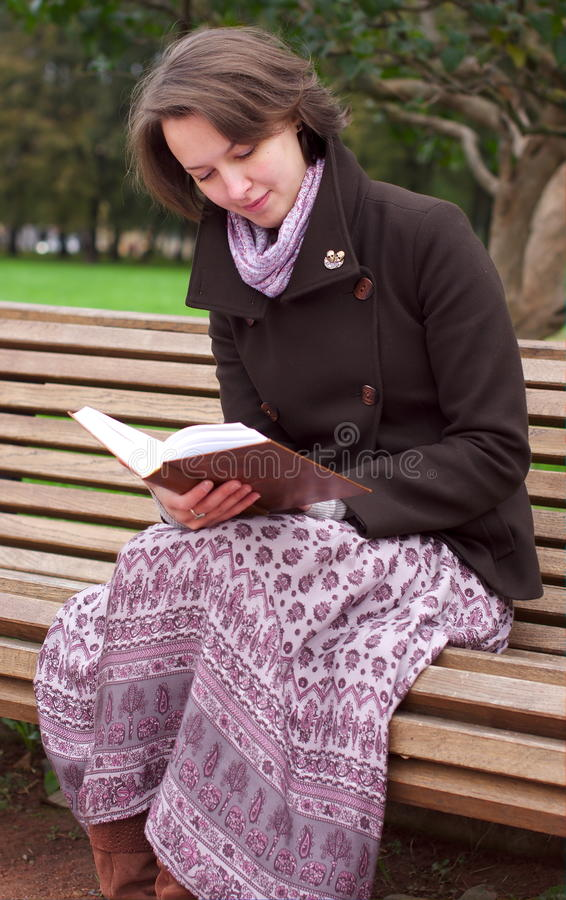 Download Pretty Woman Reading A Book On A Bench Stock Photo - Image: 21649984