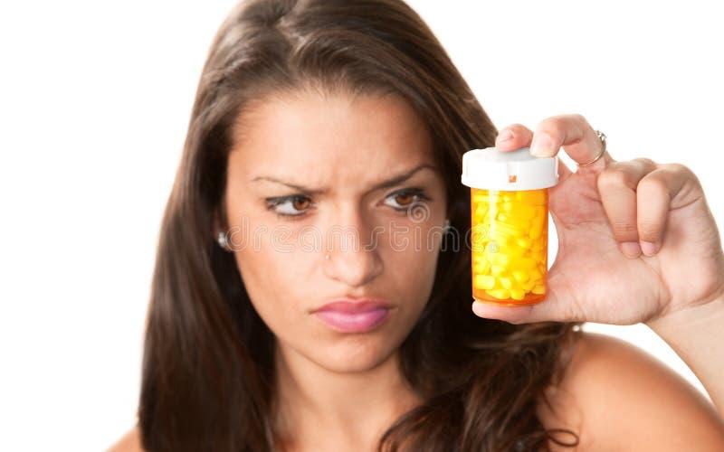 Pretty woman reading the label on a prescription b stock photos
