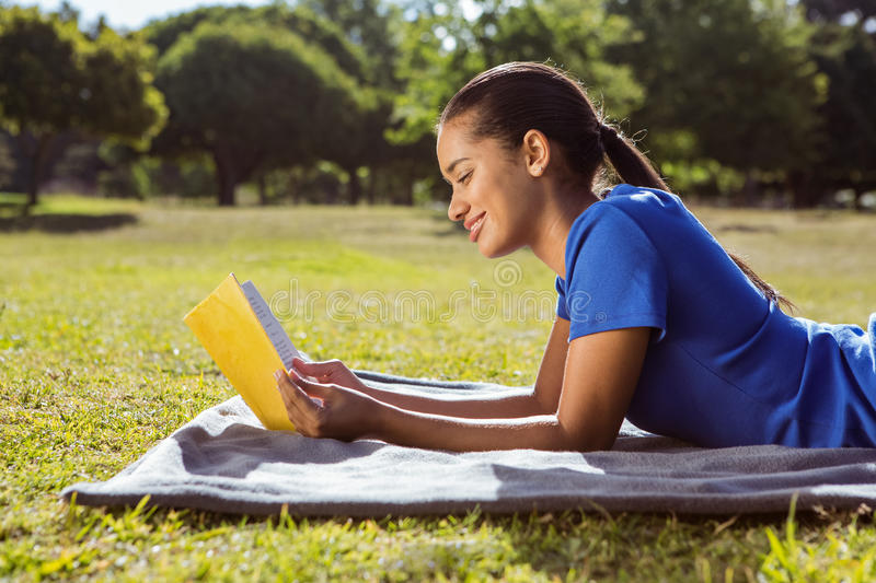 Pretty woman reading in the park royalty free stock image