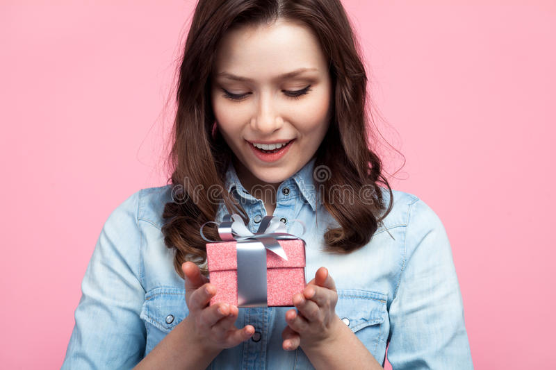 Pretty woman receiving a gift stock images
