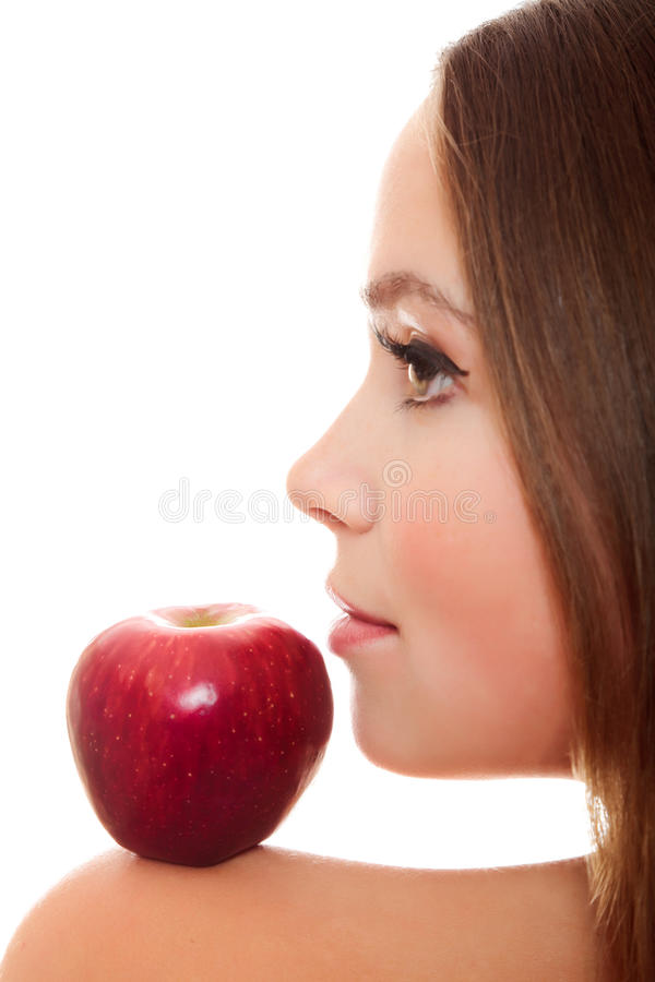 Pretty woman with red apple. On her shoulder stock image