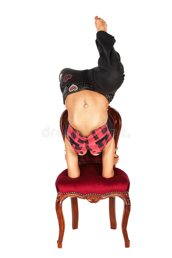 Pretty woman on red old style chair royalty free stock photography