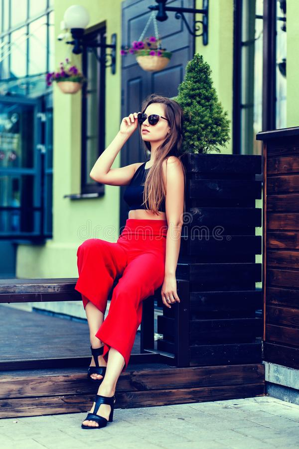 Pretty woman in red pants royalty free stock photo