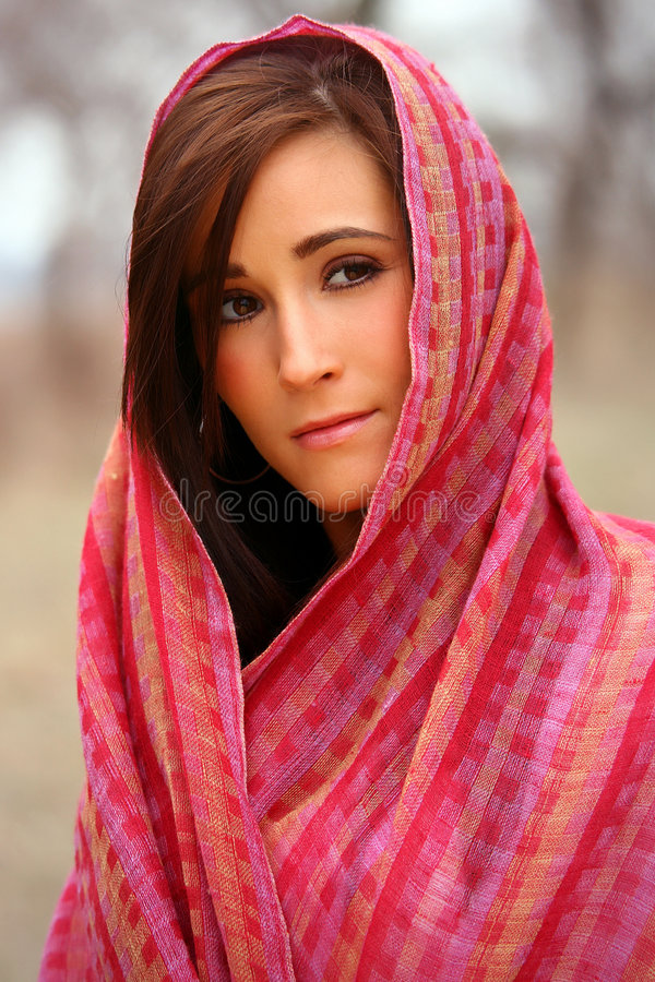 Pretty Woman in Red Shawl. Pretty young brunette woman in red shawl stock photo
