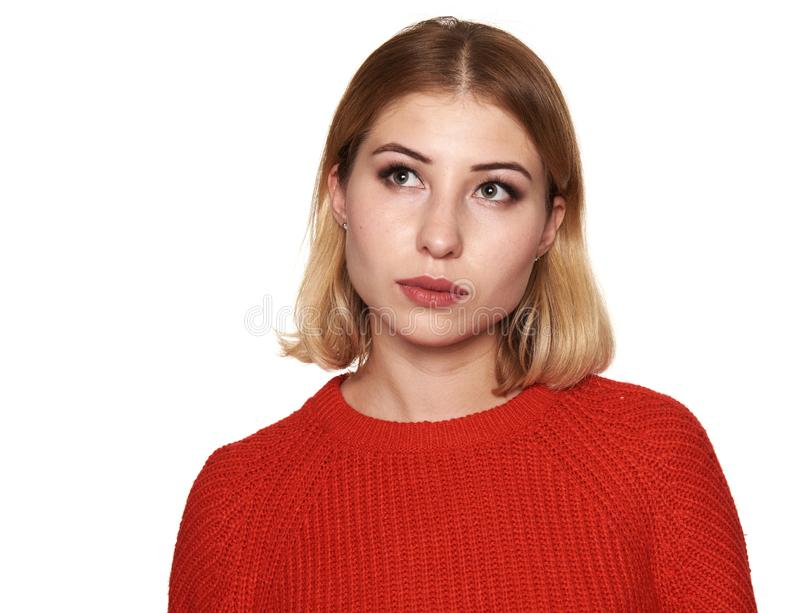 Pretty woman in red sweater looking up. Isolated royalty free stock photography