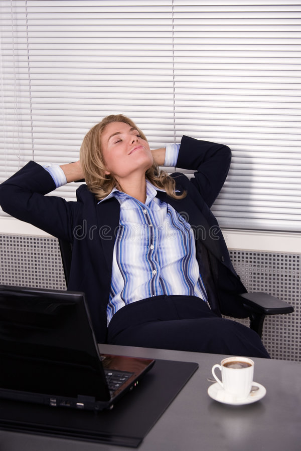 Download Pretty Woman Relaxing In Office With A Laptop Stock Image - Image: 7380449